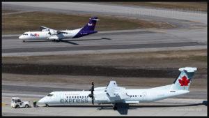 FedEx ATR 72-202F C-FTAR et Air Canada Express Bombardier DHC-8-Q-402NG (C-GIJZ) à l'aéroport international Jean-Lesage de Québec en mai 2016