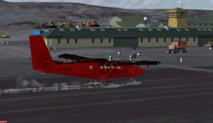 Avion Twin Otter de la British Antarctic Survey atterrissant sur la piste de Rothera, Antarctique