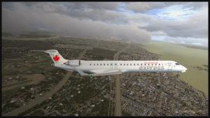 Un avion virtuel CRJ-900ER de la compagnie Air Canada (Aerosoft) est en approche pour l'aéroport international Pierre-Elliott-Trudeau de Montréal (Fly Tampa Montréal)