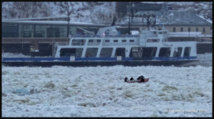 Château Frontenac ice canoe team at work by -18 C on the St. Lawrence Seaway between Lévis and Quebec.