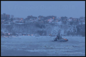 Ocean's tugboat on the St. Lawrence Seaway near Quebec City. Winter 2018, by -20 C.