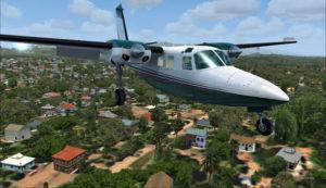 Le Shrike Commander 500S au-dessus des habitations près de Port Moresby Jacksons.