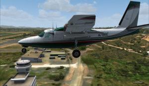Vol par le travers de la tour de contrôle de AYPY.
