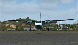 Vue frontale du Shrike Commander 500S pendant l'arrondi devant le hangar de AYPY.